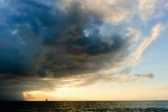 海洋日落风船风暴 图库摄影