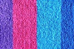 海滩毛巾的五颜六色的条纹特写镜头纹理 库存图片