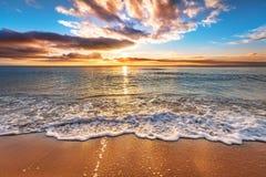 海洋海滩日出 免版税库存图片
