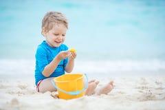 海滩男孩使用的一点 免版税库存照片