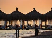 海滩的亭子在黄昏 免版税图库摄影