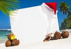 海滩的圣诞节主题的委员会 库存照片