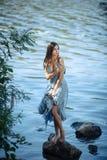 海滩的孤独的女孩 库存照片