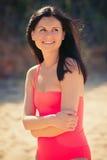 海滩的愉快的妇女基于 库存图片