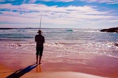 海滩的渔夫在海边 免版税库存照片