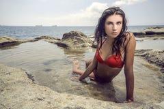 海滩的肉欲的女孩 图库摄影