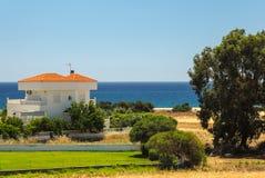 海滩的议院,罗得岛,希腊 库存图片