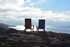 海滩睡椅剪影 库存图片