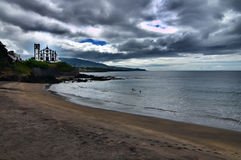 海滩蓝色教会海运天空夏天 图库摄影