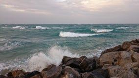 海滩风险感受产生慢的软的日落非常通知 库存图片