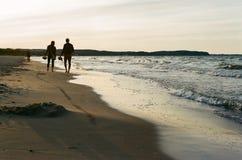 海滩风险感受产生慢的软的日落非常通知 免版税库存图片