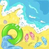 海滨, lifebuoy和触发器 免版税库存图片