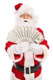 涂堆金钱的圣诞老人 库存图片