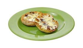 涂奶油的英格兰式松饼葡萄干 库存照片