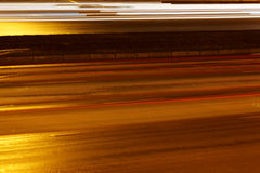 涂柏油的晚上路街道 免版税库存照片