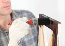 涂清漆家具的一个木零件 库存图片