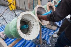 涂灰泥与水泥塔的盖子基地 免版税库存照片