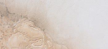 涂灰泥的水泥混凝土墙背景纹理 库存照片