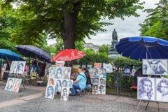 涅夫斯基远景的艺术家在圣彼德堡,俄罗斯 库存照片