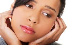 消沉的年轻美丽的妇女。 免版税库存图片