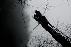 消防员剪影  免版税库存图片