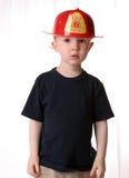 消防员将来的孩子红头发人 免版税库存照片