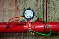 消防泵测试仪表和火管子 免版税库存图片