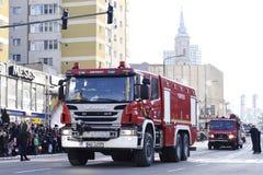 消防队员车一国庆节在札勒乌,罗马尼亚 图库摄影