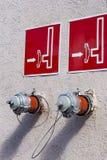 消防龙头,消防队连接,在水泥的两standpips 免版税库存照片