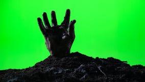 涌现从地面坟墓的蛇神手 日历概念日期冷面万圣节愉快的藏品微型收割机说大镰刀身分 绿色屏幕 010 影视素材