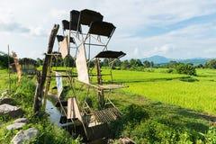 涡轮打包机在米农场 免版税图库摄影
