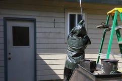 洗涤家的人力 库存照片