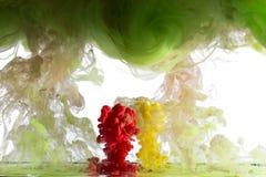 液体多色油漆的运动 免版税图库摄影