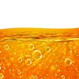 液体流动橙色波浪,海,特写镜头气泡,射线 免版税库存图片