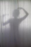 淋浴剪影妇女 库存照片