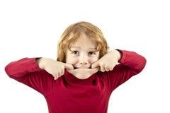 淘气儿童面孔 库存照片