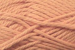 淡桔色的毛线纹理关闭 库存图片