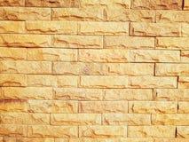 淡桔色的砖墙 免版税库存图片