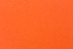 淡桔色的纸墙壁纹理背景 库存图片