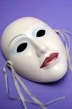 淡粉红的陶瓷面具。关闭。 库存照片