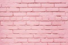 淡紫色或桃红色被风化的砖纹理或者都市墙壁背景 库存照片