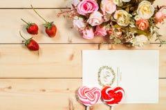 淡色口气玫瑰开花和您的文本机智的空标识符 免版税库存图片
