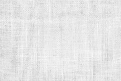 淡色抽象粗麻布或麻袋布织品纹理背景 免版税库存图片