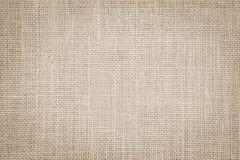 淡色抽象粗麻布或麻袋布织品纹理背景 库存照片