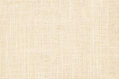 淡色抽象粗麻布或麻袋布织品纹理背景 库存图片