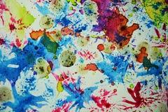淡色生动的软的蜡五颜六色的斑点和闪耀的光,抽象背景 图库摄影