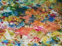 淡色绿色橙色蓝色桃红色油漆背景,闪耀的泥泞的蜡状的油漆,对比塑造在淡色颜色的背景 免版税图库摄影