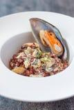 淡菜用青纹干酪和红色米 免版税图库摄影