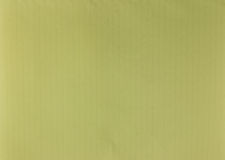 淡黄色笔记本页纹理  免版税库存图片