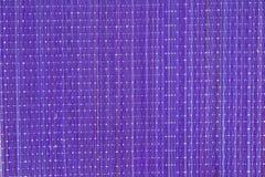 淡紫色竹餐巾作为背景 库存图片